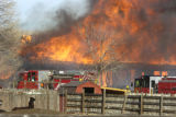 A home in the path of Wednesday's grass fire burns north of the city of Boulder, January 7, 2009...