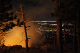 SR(0154)  A forest and brush fire burns bright in the hills bordering with Boulder, Colo., in the...