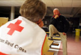 Richard Woodcock (cq) (at right) speaks to Red Cross disaster service volunteer, Eileen Hoover...