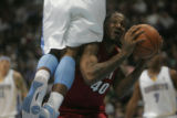 #40 Udonis Haslem (cq) of the Miami Heat fakes out #1 J.R. Smith (cq) of the Denver Nuggets during...