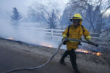DM0833  LEG56403 A firefighter with Sunshine Canyon Fire Departmetn fights the fire along Nebo...