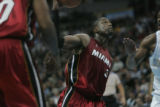 #3 Dwyane Wade (cq) of the Miami Heat drives in for a dunk during the Nuggets vs. Heat game...