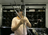 Tour tech Glenn Muncrief (cq), of TaylorMade, selects three shafts to make 3 irons for a golfer...