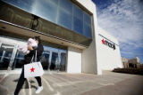 SR(104)  A Macy's customer walks out of the Westminster Mall Macy's store Thursday afternoon, Jan....