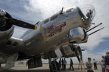 "Aviation enthusiasts admire a fully restored B17G Flying Fortress, ""Sentimental..."