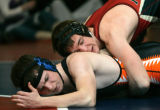 0120 Pondarosa's Steven Kelly, top, frustrates Lakewood's Jon Jaggers beating him 15-0 at the Top...