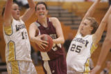 #15 Carli Moreland (cq) and #25 Kellen Wittkop (cq) of Legacy defend against #24 Brenna...