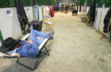 (0343) Jack Wright, of Penrose, takes a nap next to the stalls at the National Western Stock Show...