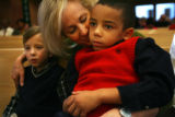MJM641  Jenifer Jones (cq), center, puts her arm around family friend, Tommy Smiley, 7, left, as...