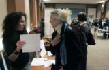 (0393) Career Consultant Aimee Cohen, left, talks with Anita Powe, right, about her resume at a...