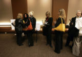 (0321) A group of jobseekers wait in line to get resume advice with Aimee Cohen, center left in...