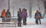 Bus riders wait for RTD during the early morning snowfall on East Colfax Avenue and Lincoln ...