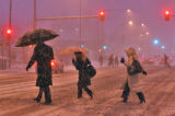 Commuters during the early morning snowfall on Broadway and 16th Street Monday January 12, 2009....