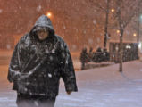 A man who didn't wish to give his name walks along Colorado Blvd. near Colfax Avenue during the...