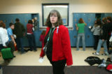 (0019) Teacher Michelle Pearson looks for students before her 6th grade social studies class at...