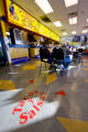 People enjoy a late lunch at Tacos y Salsas on 910 S. Federal Blvd. on Jan. 8, 2009 as part of a...