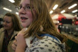 Jesekah Minnich, 11, (cq) of North Glenn holds a dutch rabbit at the rabbit display at the...