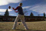 DM0068  A boy tosses a football with one of the counselors at the Tennyson Center for Children in...