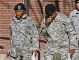 Fort Carson soldiers, Ashley Smith (cq), left, and Tammy Jackson (cq), leave Soldier's Memorial...