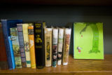 Children's books are lined on a shelf as part of the fine collection at Book World, 2353 S. Havana...