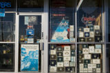 Cigar boxes decorate the windows of Cigar and Tobacco World at 5227 Leetsdale, Denver, Colo. on...