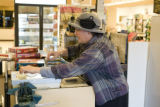 Store owner, Marcy Schreiber (cq), works the rtegister at her East Side Kosher Deli at 499 S. Elm...