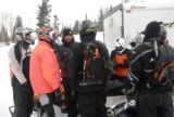 A Summit County Sheriff's Department deputy briefs a group of search volunteers before they head...