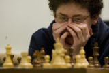 DM1837   Ben Reilly, 13, of Denver concentrates on his next move as he plays Alex Chen in the...