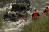 A Gilpin County rescue person leaves falls into Coal Creek from the bed of a pickup truck that...