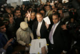 JEM104 - Pakistan's former Prime Minister, Nawaz Sharif, flashes a victory sign while holding his...