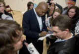 DM0540   Acclaimed actor Forest Whitaker signs autographs for students after attending a caucus...