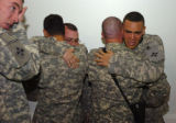Soldiers from B company, 1-8 Infantry, 3rd Brigade Combat Team, embrace following a memorial...