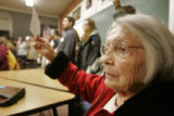 Boulder County precinct 105 democrat Elizabeth Mekkelsen  holds up his registration card in a...