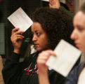 Boulder County precinct 105 democrat Mebracht Gebre- Michael  holds up his registration card in a...