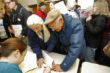 Mary and Andrew Skumanichg from Boulder join huge crowds of Boulder County democrats  registering...