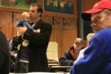 DM0720   Jeremy Schupbach, 33, holds his 11-week-old son Edwin, as he participates in the the...