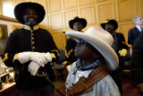 DM0848   Roosevelt McCowan, 10, of Boulder, a scout with the Buffalo Soldiers, waits outside the...
