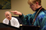MJM308  Secretary of State, Mike Coffman, left, listens to Claudia Kuhns of The Public Integrity...