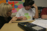 Math teacher Tammy Maccalous helps out Willie Angelo during fourth period math at Bear Creek High...