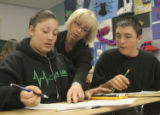 Math teacher Tammy Maccalous helps out LeAnna Ochoa (lft) and Chris Umbriaco during fourth period...