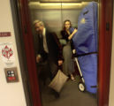 Harpist, Mia Crager (cq right),18,  and her father, Dick Crager (cq left) take the elevator to...