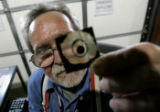 Herb Warren, mechanical tech for AVA Solar, tests a  sample cut out of a solar panel, to test...