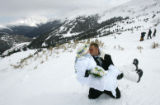 Robin and Wayne Smeal, of Cleveland, kiss at 12,000 feet after getting married at the 17th annual...