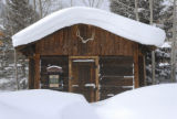 Summit Daily/Mark Fox A trapper's cabin sits engulfed in snow at the Frisco Historic Park Friday...