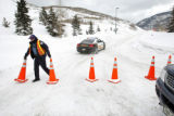 Vail Police officer Joe Ribeiro places cones in front of the on ramp to I-70 eastbound Friday in...