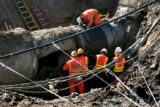 Denver Water crews cut a 18 inch section from a 66 inch steel pipe so they can remove a larger...