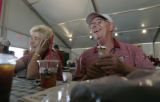 2005 Women's U.S. Open Volunteers Gail Vorreiter (left), 68, cq, and her husband Bill Vorreiter...