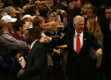 MJM259  Former President Bill Clinton greets the crowd as he enters Magness Arena as he attends a...