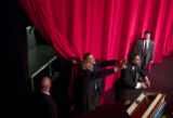 U.S. Senator Barack Obama (D) waves goodbye with Chris Rock and Cornell West after holding a...