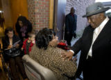 DM1036   LITTLE ROCK NINE+51568  Bishop Phillip Porter, left, says good-bye to Melba Pattillo...